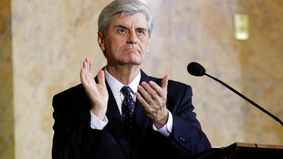 Mississippi Republican Gov. Phil Bryant applauds as he looks into the gallery after acknowledging a state business leader during his State of the State address to lawmakers, Wednesday, Jan. 21, 2015 in House Chambers at the Capitol in Jackson, Miss. Bryant says the state has not reached its full potential, but is in its best financial condition in recent history and touted the state's decreasing unemployment rate while calling on Congress to alter the federal health overhaul law to restore payments to hospitals for uncompensated care. (AP Photo/Rogelio V. Solis)