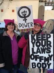 Anna Donahue of Ventura (left) and Carol Broderick of Camarillo made signs to carry in the Women's March LA two years ago. Hundreds of Ventura County residents boarded buses in Camarillo that year and headed for downtown Los Angeles. This year, women will be marching in downtown Ventura in tandem with a national march in Washington, D.C.