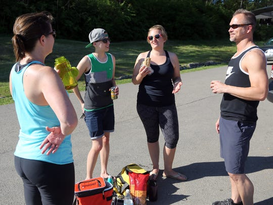 Matt Royka chats with Sarah Fairbank, Laura Poglitsch and Lyndsey Godwin after an afternoon workout and yoga session.