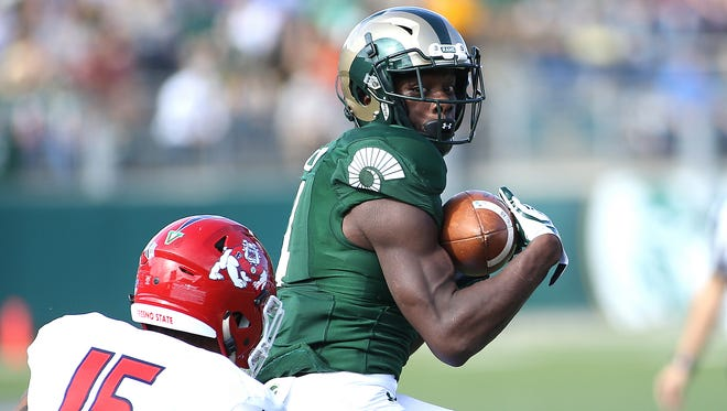 CSU wide receiver Michael Gallup checks the defense after a catch during the Rams' 37-0 win over Fresno State on Saturday at Hughes Stadium. Gallup finished the game with 126 receiving yards and a touchdown.