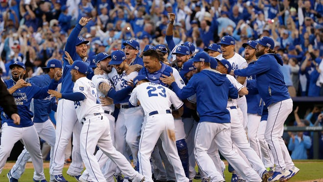 The Kansas City Royals players celebrate after the Royals defeated the Baltimore Orioles 2-1 in Game 4 of the American League baseball championship series Wednesday, Oct. 15, 2014, in Kansas City, Mo. The Royals advance to the World Series.