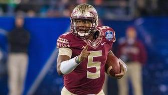 Dec 6, 2014; Charlotte, NC, USA; Florida State Seminoles quarterback Jameis Winston (5) runs the ball during the second quarter against the Georgia Tech Yellow Jackets at Bank of America Stadium. Mandatory Credit: Jeremy Brevard-USA TODAY Sports ORG XMIT: USATSI-211260 ORIG FILE ID:  20141206_mjm_bb4_194.JPG