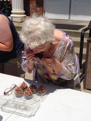 Candy Thompson, 66, of La Grange, participates in the cupcake eating contest at the 2013 Oldham County Day. She placed second after eating four cupcakes in one minute and 40 seconds.