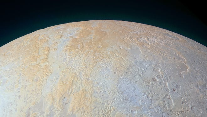 On Thursday, NASA released a color photo captured by their New Horizons spacecraft which shows off Pluto's diverse geological and compositional features in the north polar area.  It was obtained at a range of approximately 21,100 miles from Pluto, about 45 minutes before New Horizons' closest approach on July 14, 2015.