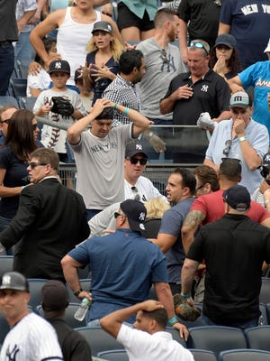 Fans react after a young girl was hit by a line drive at Yankee Stadium.