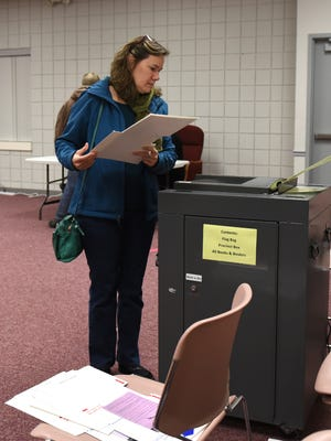 Linda Skemp casts her ballot at precinct 6 in the Village of Milford around 1 p.m. That precinct had about 360 voters at that time.