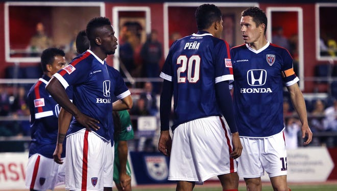 Indy Eleven defender and team captain Greg Janicki (right), 30, is an eight-year veteran defender. He speaks with teammates Erick Norales (left) and Sergio Pena (No. 20) in the Indy Eleven's 2015 NASL home opener against the New York Cosmos at IUPUI's Carroll Stadium in Indianapolis on Saturday, April 11, 2015, which ended in a 1-1 tie. The last three seasons, Janicki was a member of the San Antonio Scorpions, where he won the Soccer Bowl last year. The Rochester, Mich. native began his professional career with the Pittsburgh Riverhounds in 2008 and later played with D.C. United and the Vancouver Whitecaps.