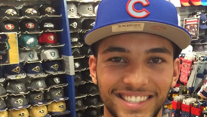 Shadow Hills graduate Tyson Miller shows off his Chicago Cubs hat at Lids on Friday. He was drafted by the Cubs in the fourth round.