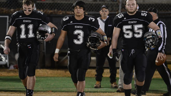 Robbinsville's Skyler Matheson (11), Cruz Galaviz (3) and Creed Lovin (55) were part of the NCHSAA 1-A football champion Black Knights (16-0).