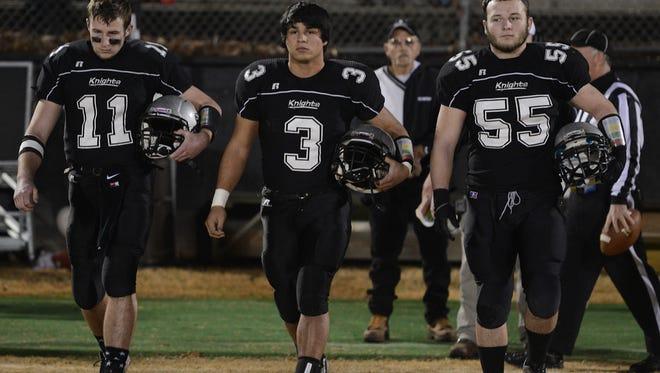 Robbinsville's Skyler Matheson (11), Cruz Galaviz (3) and Creed Lovin.