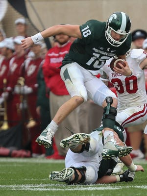 Michigan State Spartans' Connor Cook runs for a first down against the Indiana Hoosiers on October 24, 2015 at Spartan Stadium in East Lansing.