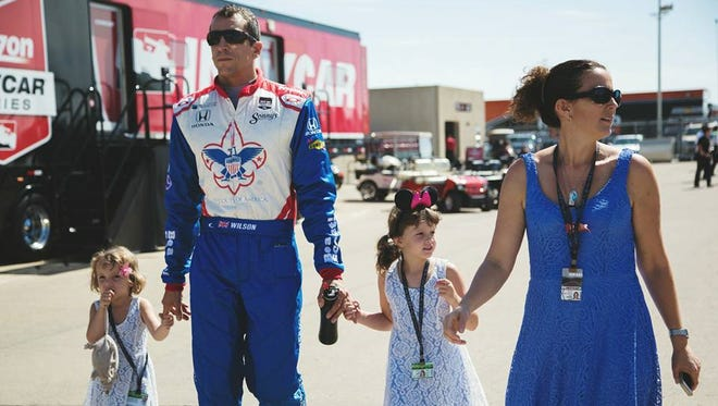 IndyCar driver Justin Wilson walks with wife Julia and daughters Jane (middle) and Jessica (left).
