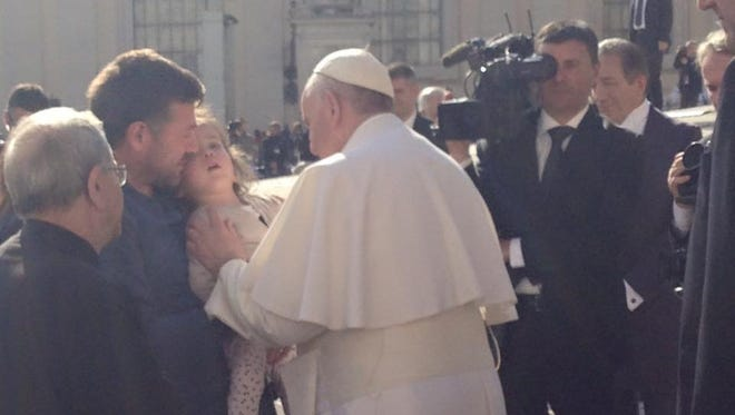 Pope Francis met with Rowan SOM researcher Paola Leone and families of children born with Canavan disease in Rome last month. In this cell phone photo shot by Leone, the Holy Father blesses one of her patients, Aurora Palombi, as she is held by her father, Gabriele Palombi.