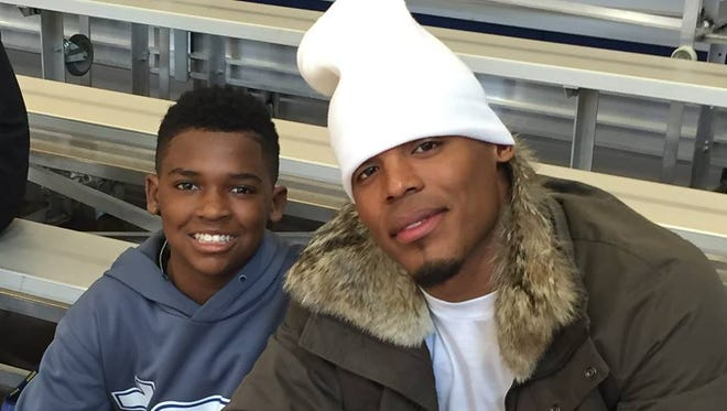 Cam Newton and TSU Coach Rod Reed's son, Marcel.