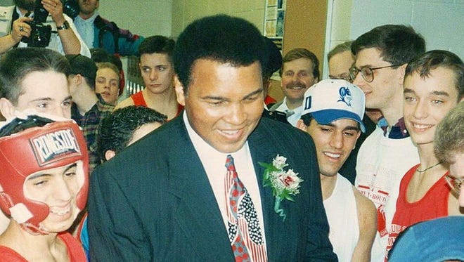 Muhammad Ali in his element at the Aquinas Mission Bouts, 1994.