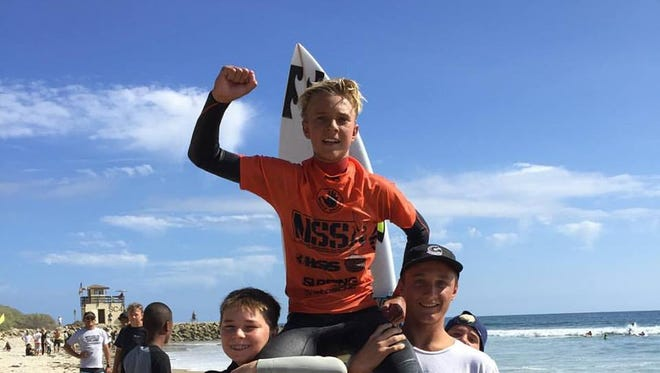 Tommy Coleman being chaired to beach after winning title last weekend at NSSA Championships in the Middle School Division