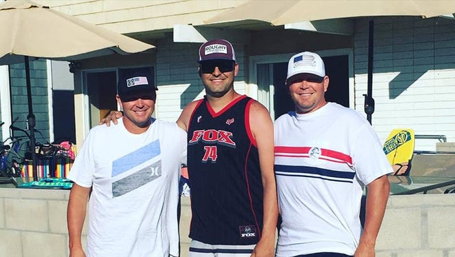 From left, Steve Frost, 50, Jesse Martin, 35, and Stuart Frost, 50, helped save a toddler at Newport Beach who had gotten buried in the sand when a hole collapsed on him.