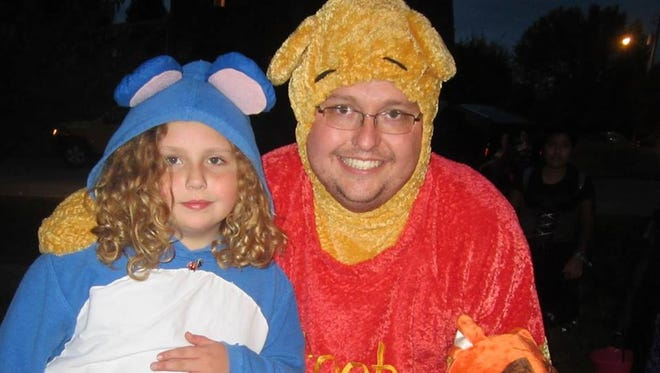 David Goddard plays Pooh to daughter Jessie's Eeyore and son Charles's Tigger.