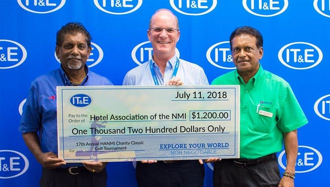 IT&E presented a donation of $1,200 to members of the Hotel Association of the Northern Mariana Islands on July 11.
