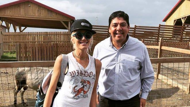 Gwen Stefani poses alongside Stephen Donnelly at Animal Adventure Park.