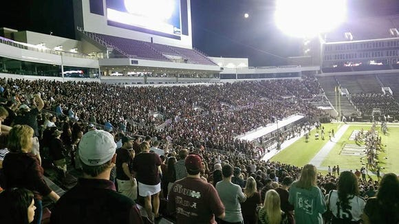 Mississippi State fans do the Cowbell Yell at Davis Wade Stadium.