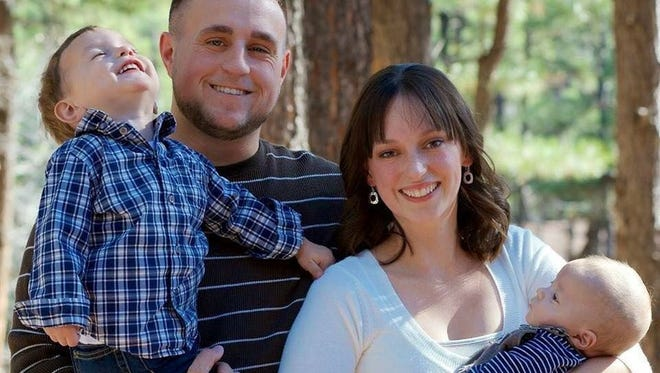 Megan Lange, the Phoenix fire dispatcher who was killed in a wrong-way wreck, is pictured with her husband, Patrick, and sons Sean (2 years) and Miles (6 months).