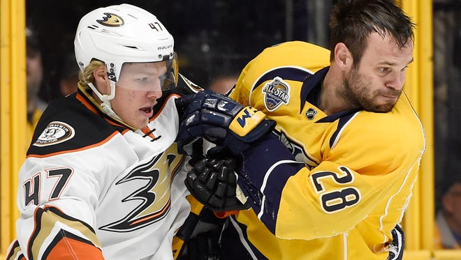 Ducks defenseman Hampus Lindholm (47) and Predators center Paul Gaustad (28) go after the puck in the first period of Game 6 Monday April 25, 2016 in Nashville, Tenn.