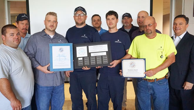 At the recent event at the Pennsylvania American Water's treatment plant in Hershey, the President's Award from the Partnership for Safe Water for delivering drinking water that surpasses regulatory standards was awarded to (from left) Nate Koch, Al Midlick, Justin Brame, Mike Barger, Shawn Wiley, Ricky Bitting, Mike Rager, Jon Prawdzik, Steve Grizzle and Chris Abruzzo.                      Only 15 treatment facilities in Pennsylvania have earned this honor.