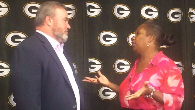 Green Bay Packers coach Mike McCarthy talks with Green Bay resident Sharon Harper at Lambeau Field after McCarthy and the Packers each donated $100,000 to the Green Bay Police Foundation on Thursday, Sept. 8. Harper is the director of the Bring Your Own Five youth basketball league in the summer at Green Bay's Fisk Park. The community program is supported by Green Bay police.