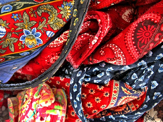 Detail of just some of the many Vera Bradley patterns on bags owned by Lori Fulk. Most all patterns when introduced are retired from the market after two years.  Frank Espich/The Star