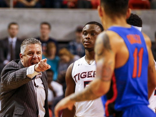 Auburn head coach Bruce Pearl reacts over a call and