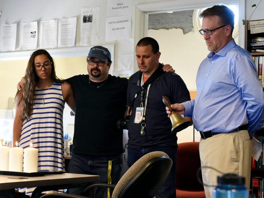 AP APTOPIX SHOOTINGS NEWSPAPER MOMENT OF SILENCE A USA MD