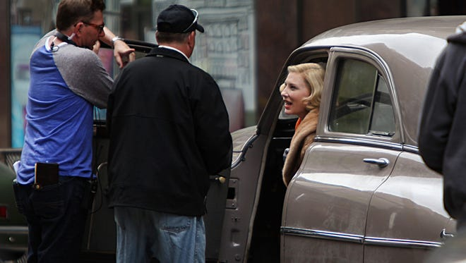 "Cate Blanchett talks to ""Carol"" producers after shooting a scene on Race Street in April."