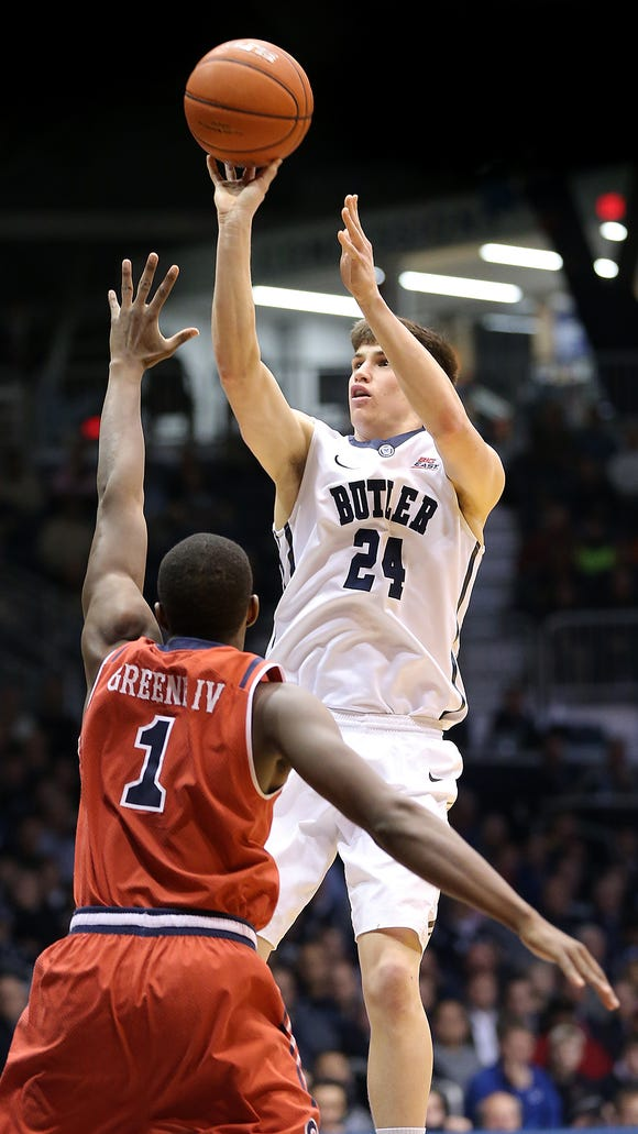 Butler's Kellen Dunham shoots a 3-pointer over St. John's Phil Greene IV in the second half of Butler's 85-62 victory on Feb. 3, 2015 at Hinkle Fieldhouse.