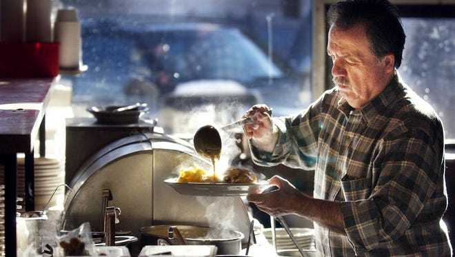 Nectar Rorris serves up lunch in 2003. A video by the Burlington Free Press about his iconic venue won a regional Edward R. Murrow Award.