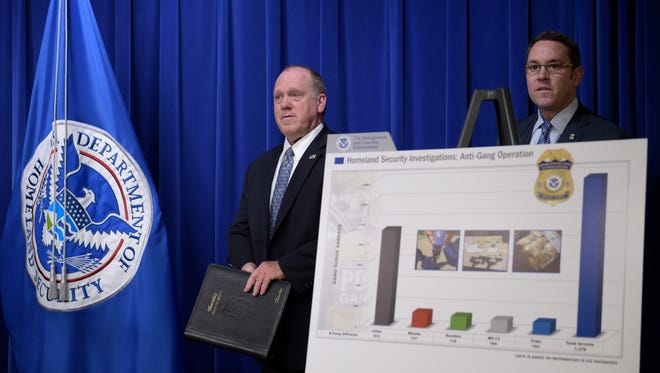 U.S. Immigration and Customs Enforcement acting Director Thomas Homan, left, and Homeland Security Investigations deputy executive associate director Derek Benner, right, arrive to speak at a news conference in Washington on May 11, 2017, to announce the results of a national operation targeting gang members and associates.