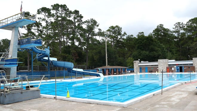 The water at H. Spurgeon Cherry Pool is calm Friday, but it will be churning Monday morning when lap swimmers bring the first wave of reopening to Gainesville city swimming pools.