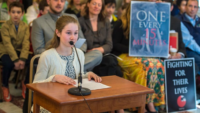 Taegan Yardley, 12, of Charlotte, a student at the Endeavour Middle School, speaks in favor of a bill to ban the sale of ivory and rhinoceros horn before the House Committee on Fish, Wildlife and Water Resources at the Statehouse in Montpelier on Wednesday.