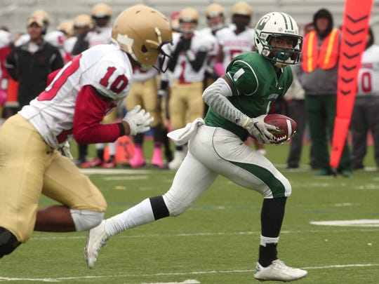Delbarton runningback Andrew Sanders heads to the end zone for a first half touchdown vs Mt Olive during their football matchup. The Green Wave beat the Marauders 37-0. October 3, 2015, Morristown, NJ.