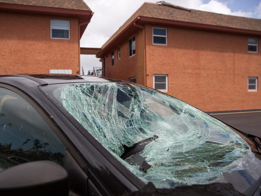 Sorrento Villas resident Marty Lawton's air conditioning units were blown off the roof by Hurricane Irma, smashing into a parked car's windshield, as seen in North Naples on Monday, September 11, 2017.