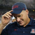 Arizona football coach Rich Rodriguez reacts on the field after defeating the California Golden Bears, 49-45, on the final play of the game Saturday, Sept. 20, 2014, in Tucson, Ariz.