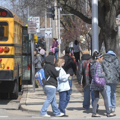 Battle Creek Public Schools buses on West Van Buren