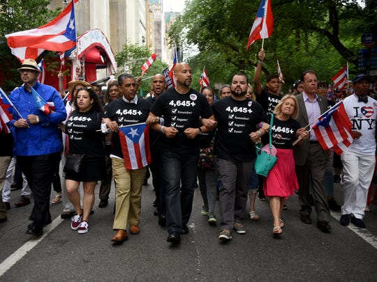 Ruben Diaz Jr., fifth from left, Bronx borough president, marches with a group of state and city officials, many wearing shirts with the number 4,645 on them, referring to the hurricane's estimated death toll according to a recent Harvard study as opposed to the government's official count, 64.The sixty-first annual National Puerto Rican Day Parade was held on Sunday, June 10, 2018 along Fifth Ave. in New York City.