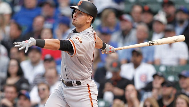 Joe Panik hits a leadoff home run during the first inning against the Chicago Cubs at Wrigley Field.