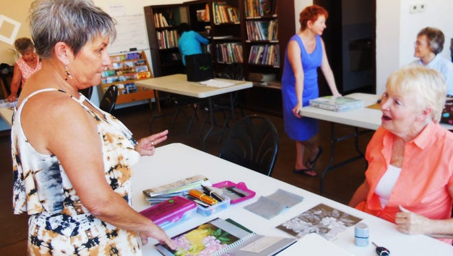 Bunny Wiseman, left, gives personalized help to each of her drawing students.