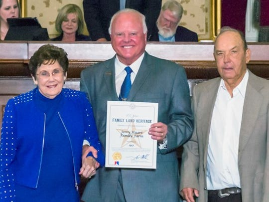 Agriculture Commissioner Sid Miller, center, recognizes representatives of the Jerry Stuart Farm in Fisher County as recipients of the Family Land Heritage program.