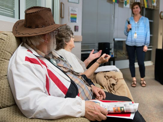 Gerald and Elsie Hiatt listen to Liz Hoffman, a public