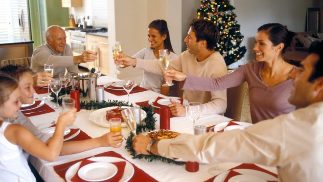 Family toasting at Christmas meal