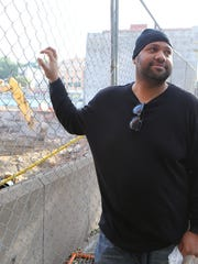 Jay Muhammad from Yonkers looks over the property where