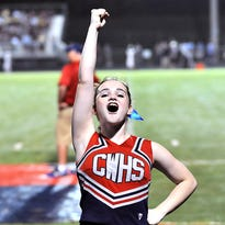 Creek Wood cheerleader Emma Coursey keeps the Red Hawk fans fired up. Fairview at Creek Wood. Aug. 27. Red Hawk Stadium.